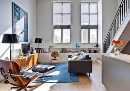 Loft White Laminate Flooring Grey Sofa And Brown Chair With Blue Rug Also Black Floor Lamp With