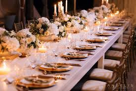 luxury wedding dinner setup with gold chargers cutlery