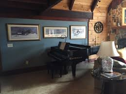 after piano wall p buckley moss paintings log home interior