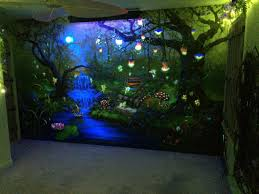 enchanted forest bedroom mural under the blacklight at night
