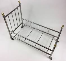 miniature antique metal bed frame on casters jonny williamson