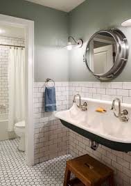 bathroom with green walls white subway tiles and antique vanity