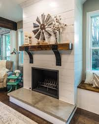 shiplap on fireplace rustic mantle also love the coffee table