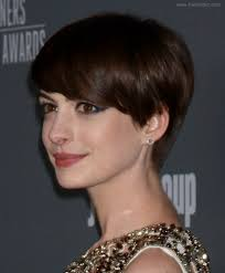 anne hathaway slightly grown out pixie haircut with heavy