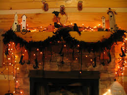 halloween light strings glitter and feathers make a fun halloween garland with a little