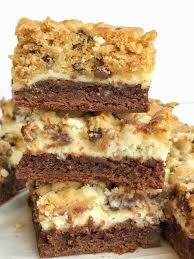 chocolate chip cookie cheesecake brownie bars together as family