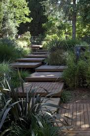 stagger some simple platforms up your garden slope going up the