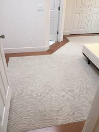 mohawk dramatic flair in hushed beige carpet maple hardwood floor