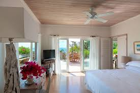 beach cottage three bees villa each of the beach cottage s two bedrooms has an ensuite bathroom and sliders that open onto the terrace