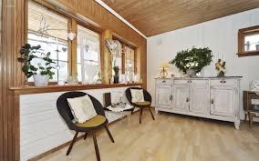 Solid Wood Laminate Flooring Vintage Style Living Room Furniture Chandelier Above Table Beige