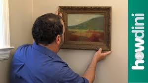 how to hang a picture frame how to hang a picture frame on the wall youtube