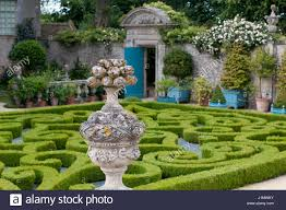 Topiary Planters - buxus sempervirens and topiary in formal parterre garden with
