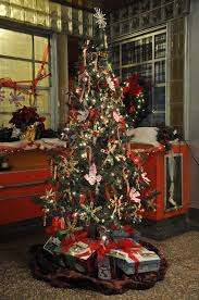 museum s tree reflects ornaments through the decades
