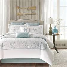 Vintage Comforter Sets Patterned Bedding Sets White Wooden Bunk Bed Frame Behind Blue