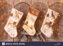 socks hanging over the fireplace for gifts from santa stock photo