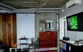 handmade barn door makes architects u0027 condo remodel