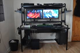 gaming setup with ps3 pc surround sound system logitech g25