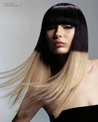 long straight hairstyle with a contrast of black and blonde hair