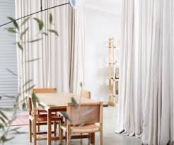 How To Make A Curtain Room Divider - how to add privacy and make a statement with a curtain wall