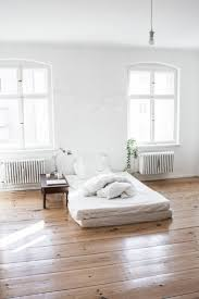 if you try minimalist bedroom design with wood flooring and white