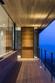 mountain ridge hosting dramatic modern architecture house in