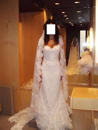 hairstyles with mantilla veil hairdo with cathedral length veil and lace dress with straps