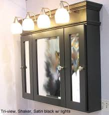 black framed recessed medicine cabinet i like how the vanity lights are on extended off the wall that s