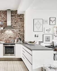 kitchens with brick walls modern white kitchen with brick wall