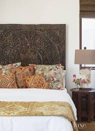 Balinese Carved Wall Art As Headboard And Quilt Teal And Gold - Bali bedroom design