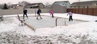 dad builds ice rink for children attracts hockey player