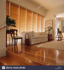 Wooden Venetian Blind White Sofa In Front Of Window With Wooden Venetian Blind In Modern