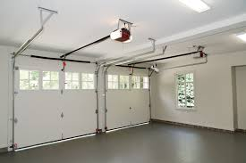 Installing An Overhead Garage Door Door Garage Overhead Garage Door Roll Up Doors Garage Door Motor