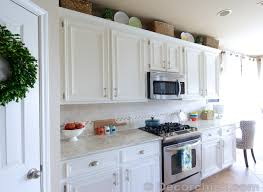 Modern White Kitchen Cabinets With Laminate Countertops And Decor