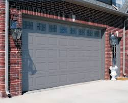 red brick house with a garage door and front door color gray and