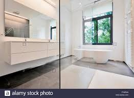 Corian Bathtub Bathtub In Corian Faucet And Shower In Tiled Bathroom With