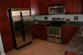 oak kitchen cabinets with stainless steel appliances cherry maple wood kitchen cabinets
