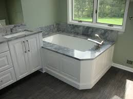 astounding grey marble top wooden bathroom vanity with white door