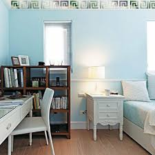 bedroom with blue wall colors and white desk also decorated with