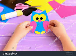 small child holds paper owl his stock photo 476278120 shutterstock
