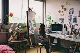 gorgeous home art studio interior in loft with veneer workstation