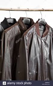 man u0027s leather jackets on clothes hanging rail stock photo royalty