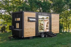 tiny home clad in burnt wood packs a ton of luxury into just 240