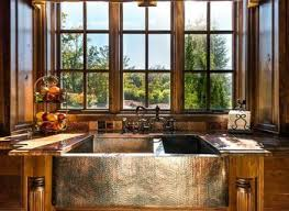 traditional kitchen with raised panel mexican tile backsplash