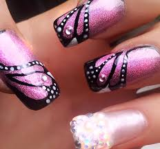 creative nail design the step for a nail butterfly is placing the monarch