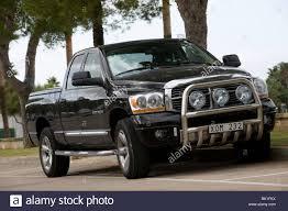 dodge truck car black dodge ram 1500 hemi pickup truck parked in a car park in