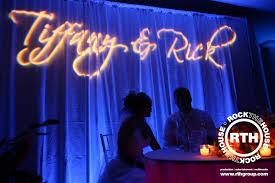 wedding backdrop monogram lighting drapery rock the house
