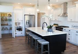 black island and white cabinets kitchen iowa cities black and white kitchen home