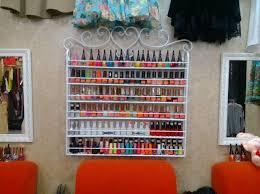 cheap wrought iron wall mounted storage finishing nail polish