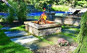 how to light a fire pit custom fire pit design build autumn leaf landscape design