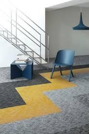 mixed carpet tiles give an eclectic quilt look carpet tiles